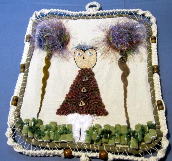 Marco hecho por Frank, and quilt hecha a mano por Patricia.
