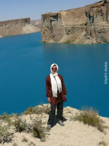 Our traveler posing with the lake beauty of Band-e Amir National Park behind her.